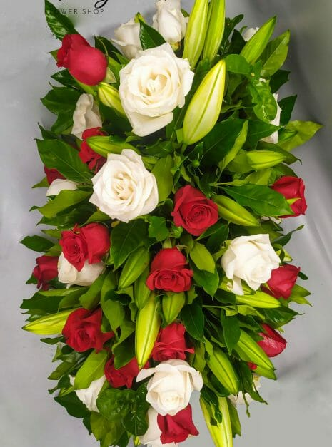 palma funebre en colores rojo y blanco