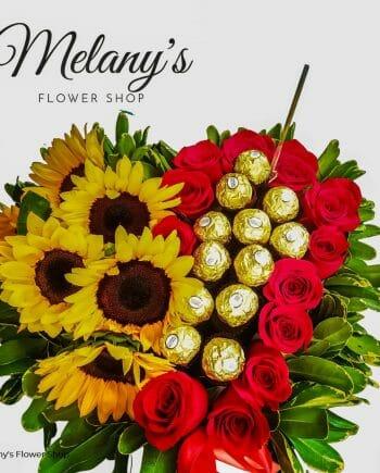 arreglo floral en forma de corazon con girasoles, rosas y chocolates en el salvador